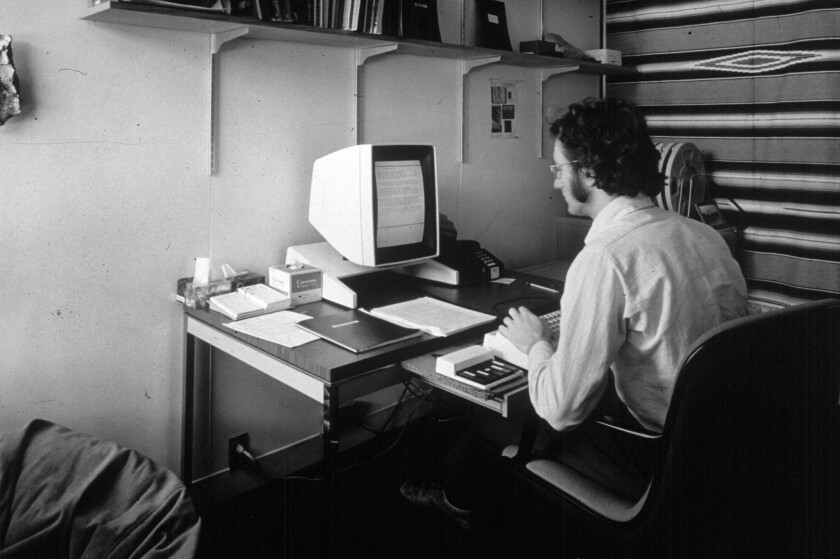 Larry Tesler using the Alto, an early PC, with a keypad input device later replaced by the mouse.