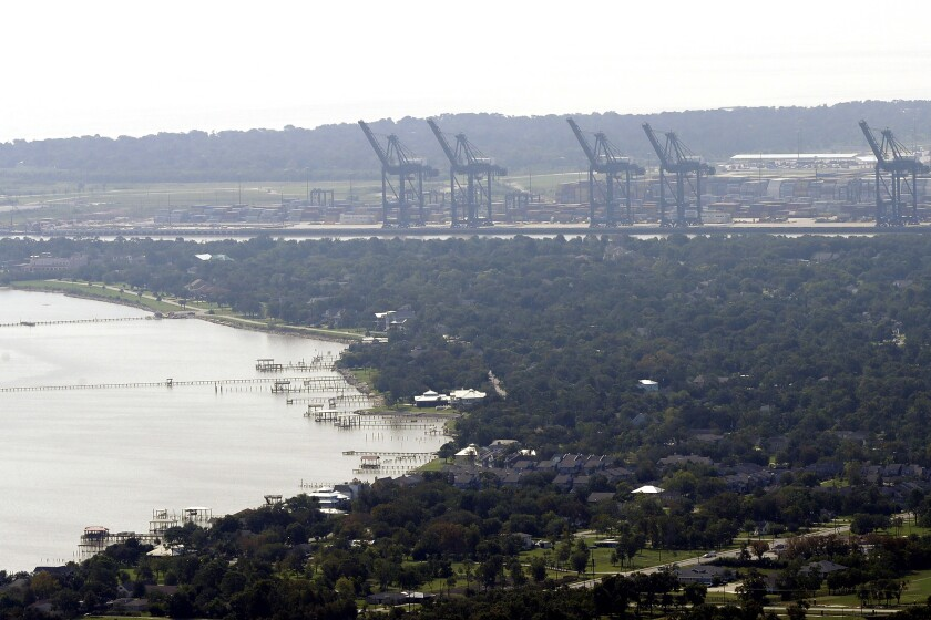 FILE - This Sept. 1, 2017, file photo shows cranes at the Port of Houston in Houston. A major U.S. port was the target last month of suspected nation-state hackers. The Port of Houston, a critical piece of infrastructure along the Gulf Coast, issued a statement Thursday that it had successfully defended against an attempted hack in August and that no operational data or systems were impacted. (AP Photo/David J. Phillip, File)