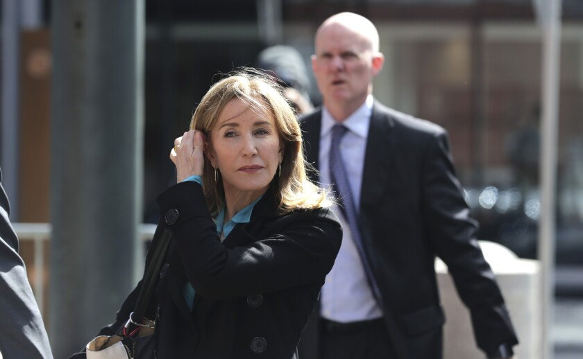 Felicity Huffman arrives at federal court in Boston on April 3 to face charges in a nationwide college admissions bribery scandal.