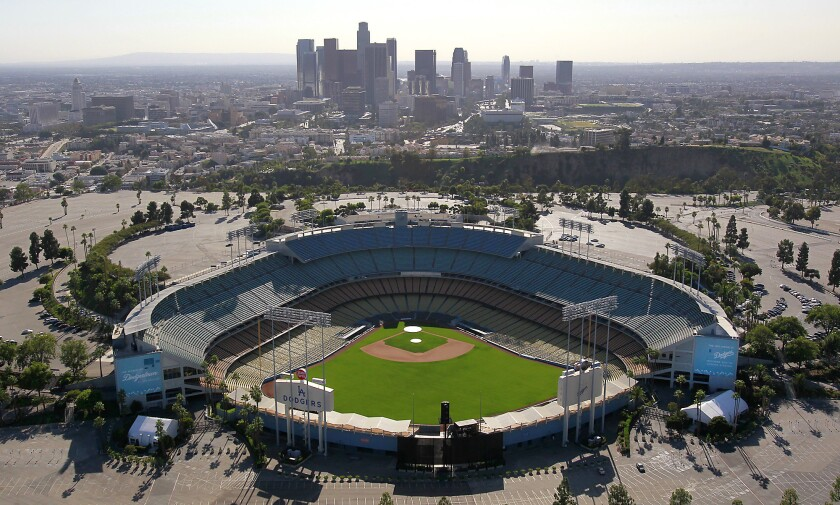 An aerial view of L.A.'s Dodger Stadium and vast parking lot.