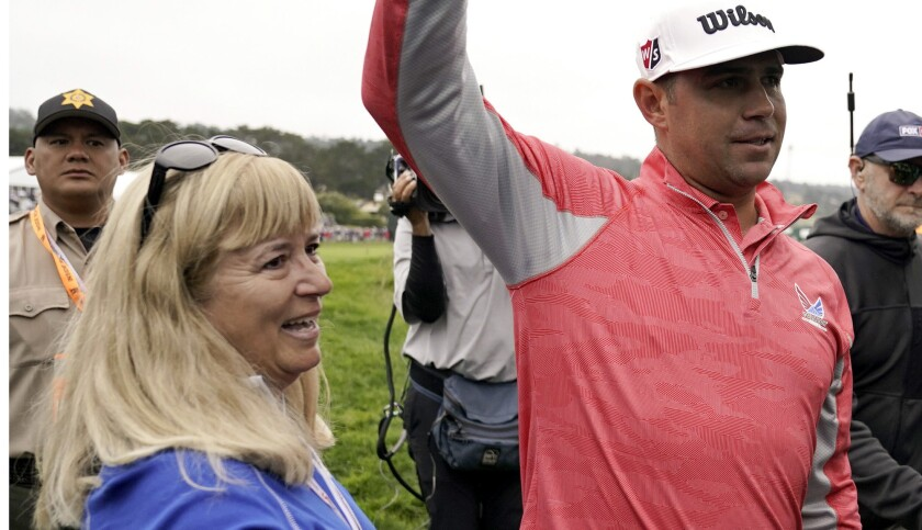 Gary Woodland celebrates after winning the U.S. Open Championship golf tournament with his mother Li