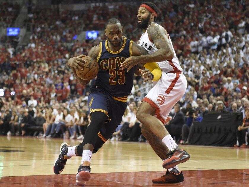 Cleveland Cavaliers forward LeBron James drives to the basket as Toronto Raptors forward James Johnson defends during the second half of Game 6 of the NBA basketball Eastern Conference finals, Friday, May 27, 2016, in Toronto. (Frank Gunn/The Canadian Press via AP)