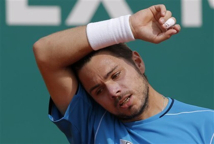 Stanislas Wawrinka of Switzerland reacts during his quarter final match of the Monte Carlo Tennis Masters tournament in Monaco against France's Jo-Wilfried Tsonga, Friday, April 19, 2013. (AP Photo/Lionel Cironneau)