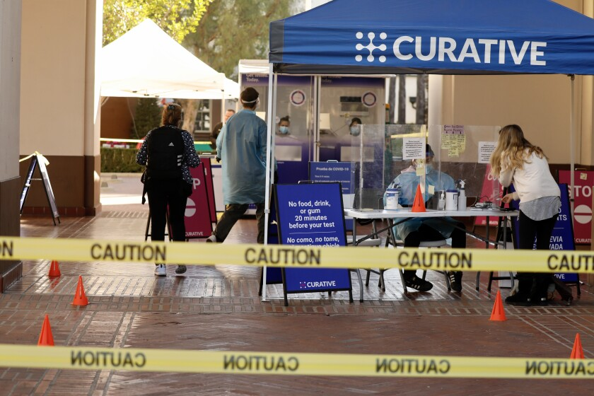 A Curative COVID-19 testing kiosk is set up outside Union Station in downtown Los Angeles.