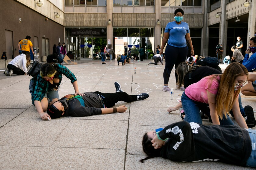 Protesters gathered outside San Diego City Hall to draw 140 chalk outlines.
