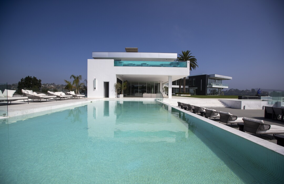 A view of a pool with a 4,000-square-foot bedroom above it at The One.