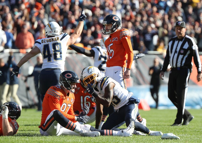 Chicago Bears kicker Eddy Pineiro stands alone after missing a 41-yard field-goal attempt as time expires in the Chargers' 17-16 win Sunday at Soldier Field.