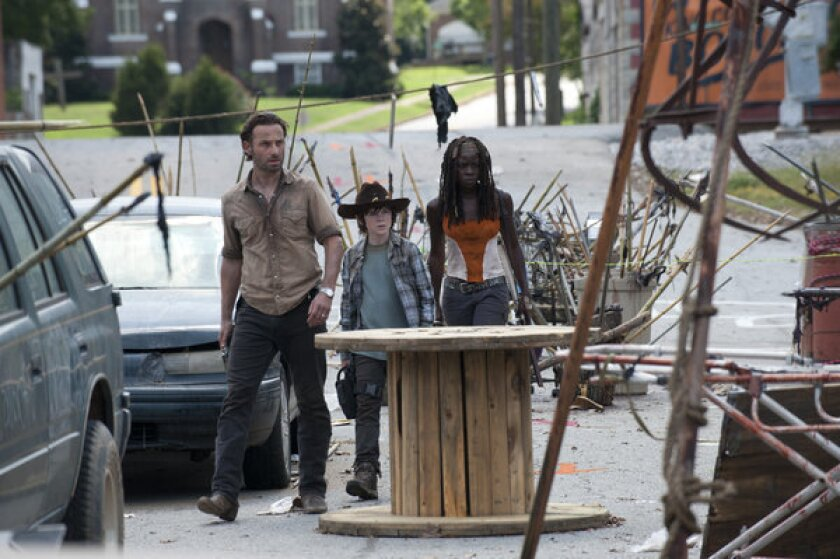 Rick (Andrew Lincoln, left), Carl (Chandler Riggs) and Michonne (Danai Gurira) go to Rick and Carl's old hometown to retrieve guns and ammunition.