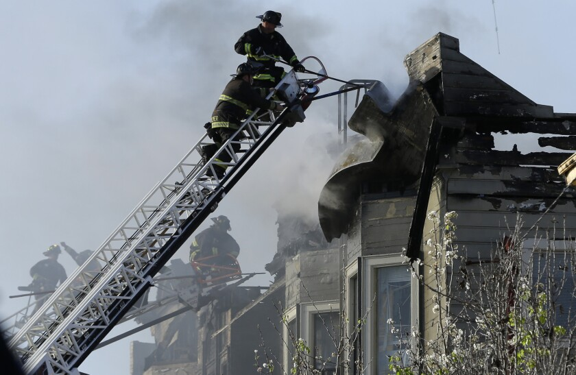 Firefighters battle an early-morning apartment fire Monday in Oakland.