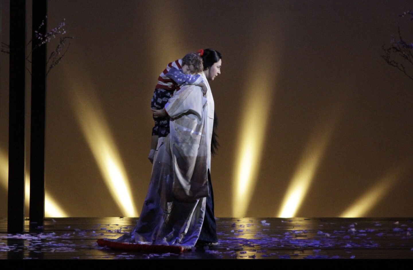 """Oksana Dyka (Cio-Cio-San) and Garret Chang (Cio-Cio-San's child) in L.A. Opera's new production of Puccini's """"Madame Butterfly"""" at the Dorothy Chandler Pavilion."""