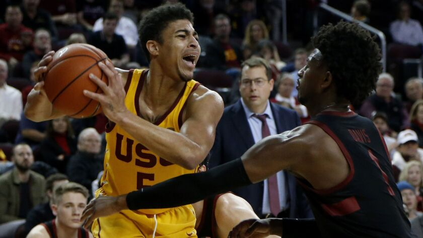 Southern California's Derryck Thornton (5) is defended by Stanford's Daejon Davis (1) during an NCAA