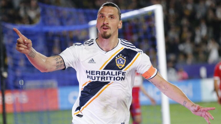 Galaxy forawrd Zlatan Ibrahimovic (9) celebrates his goal against Chicago Fire.