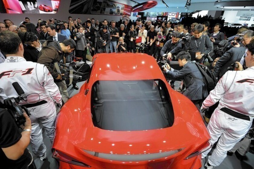 Detroit Auto Show: Carmakers showcase speed, strength and beauty