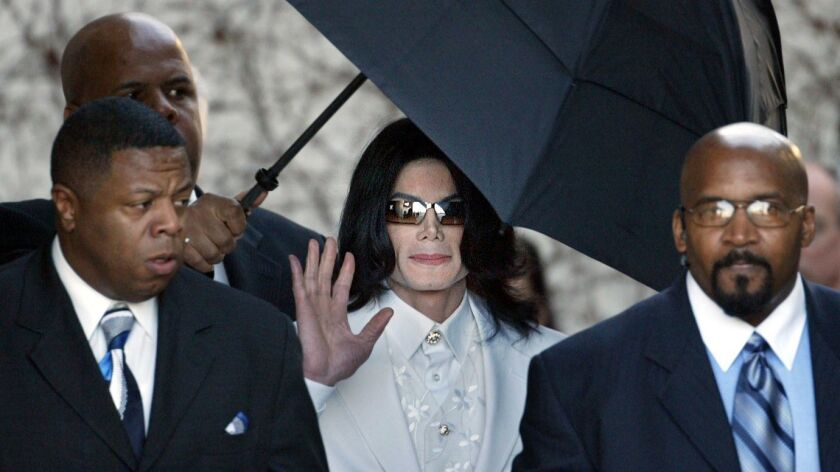 Pop singer Michael Jackson leaves court Jan. 31, 2005, in Santa Maria, Calif, at the end of court day during first day of jury selection in Jackson's child molestation trial.