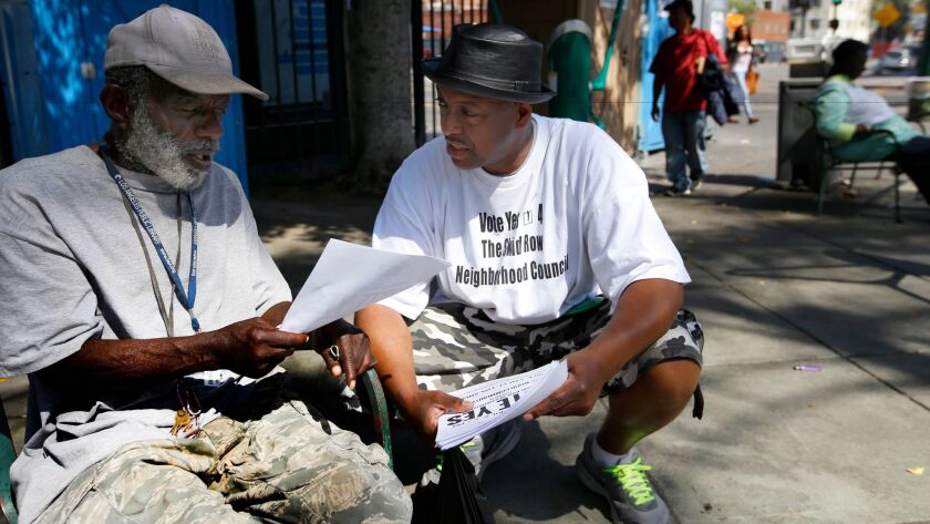 LOS ANGLES, CA APRIL 5, 2017: General Jeff Page, right, speaks with Terry Prescod, left, at in Gla