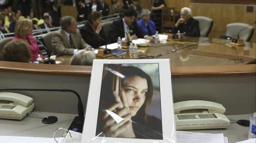 FILE - In this March 25, 2015, file photo, a portrait of Brittany Maynard sits on the dais of the Se