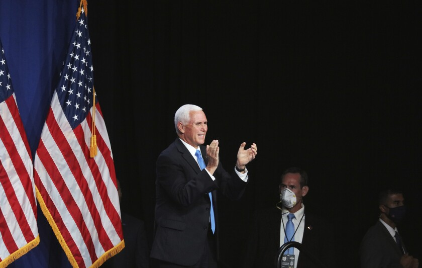 Vice President Mike Pence arrives to speak on the first day of the Republican National Convention in Charlotte, N.C.