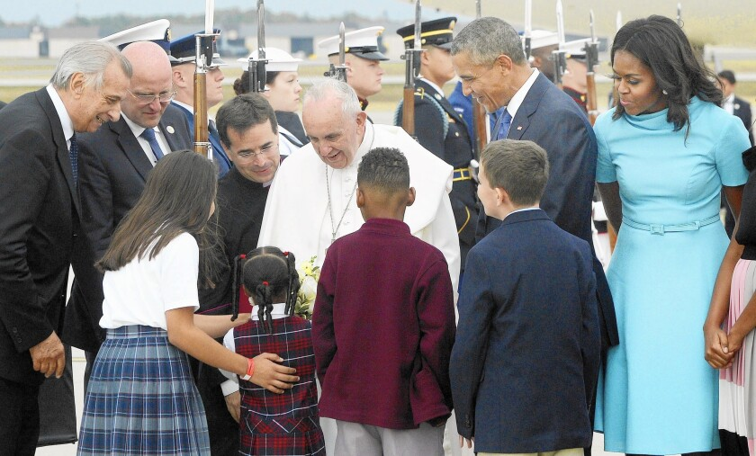 President Barack Obama and First Lady Michelle Obama welcome Pope Francis.