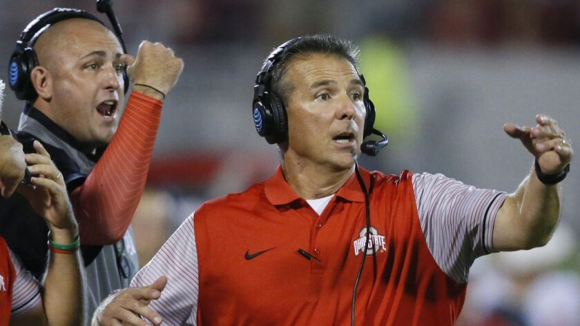 Ohio State coach Urban Meyer, right, and then-assistant coach Zach Smith react to a play from the sideline of a game against Oklahoma on Sept. 17, 2016.