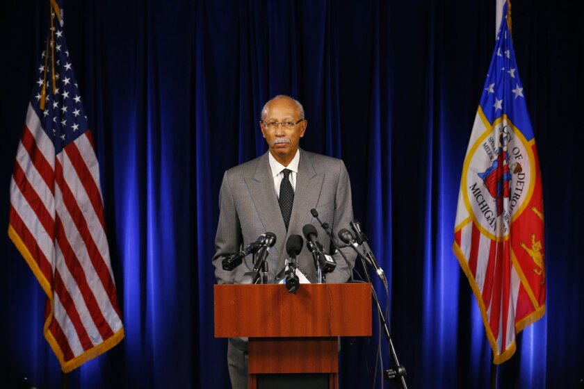 Detroit Mayor Dave Bing speaks at a news conference in Detroit Tuesday, Dec. 3, 2013. Detroit is eligible to shed billions in debt in the largest public bankruptcy in U.S. history, a judge said Tuesday in a long-awaited decision that now shifts the case toward how the city will accomplish that task. (AP Photo/Paul Sancya)
