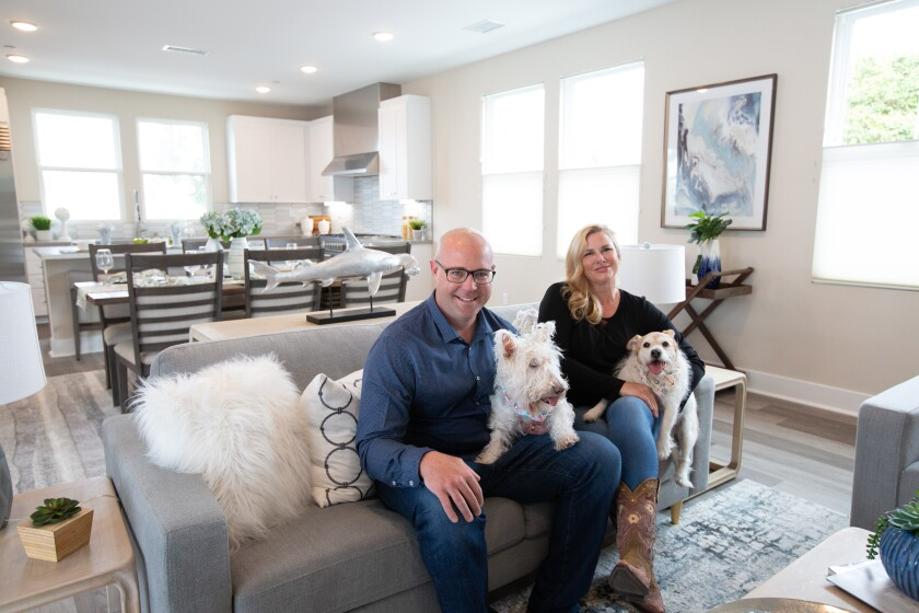 Mike and Liz share their new single-family home in Carlyle with their four-legged family members.