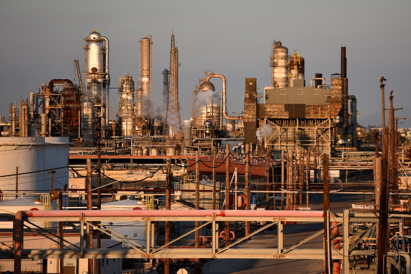 Scaffolding and smokestacks are seen at a Torrance refinery
