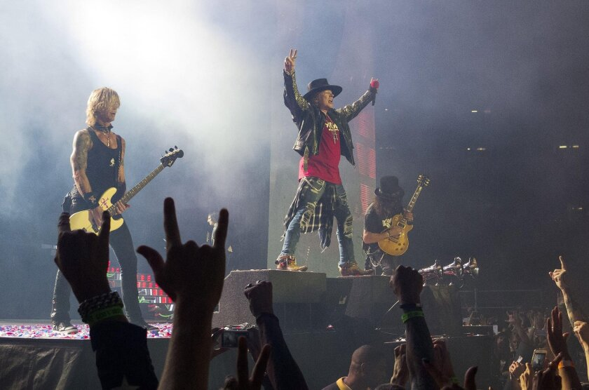 Duff McKagan, left, Axl Rose and Slash of the rock band Guns N' Roses perform Aug. 22 during the final North American show of the band's Not In This Lifetime reunion tour at Qualcomm Stadium in San Diego, CA.