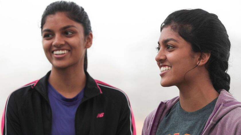 Twin sisters Priyanka, left, and Gitanjali Multani, 17, of Carmel Valley, have been developing promising research at UCSD on an ovarian cancer test. On Sunday, they served as grand marshals at the O