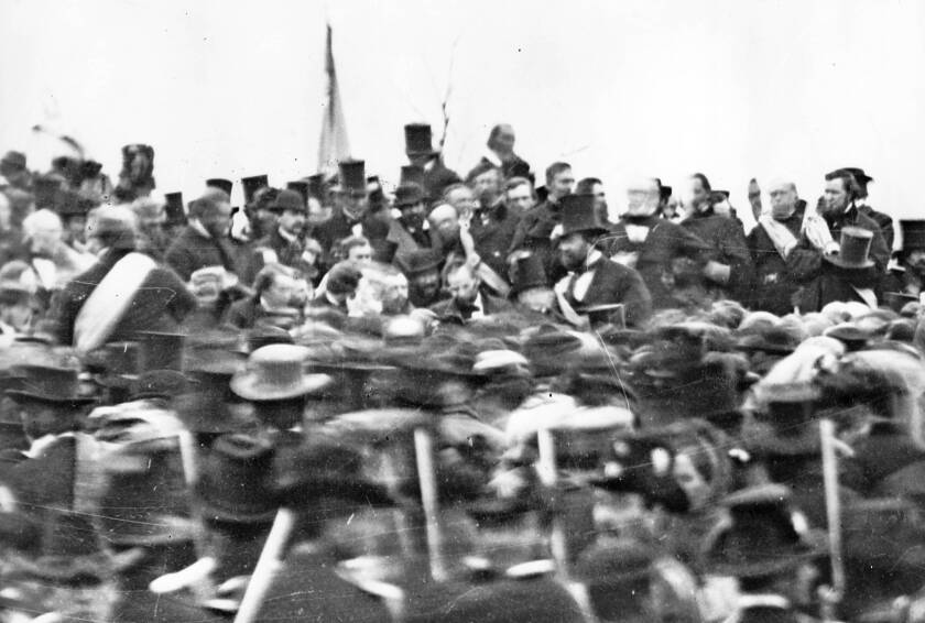 President Lincoln, center with no hat, attends the dedication of a cemetery at the Gettysburg battlefield in 1863. On the 150th anniversary of Lincoln's famed Gettysburg Address, the Harrisburg, Pa., Patriot-News is apologizing for calling it silly and uninspiring at the time.