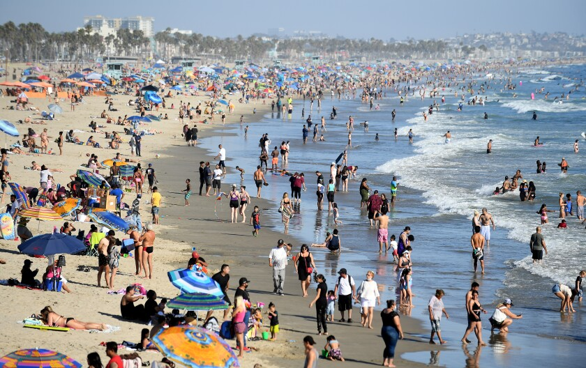 Beachgoers enjoy a sunny summer day in Santa Monica in August.