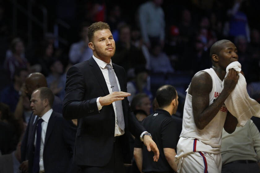 Clippers forward Blake Griffin looks on from the bench during a game against the Miami Heat on Jan. 13.