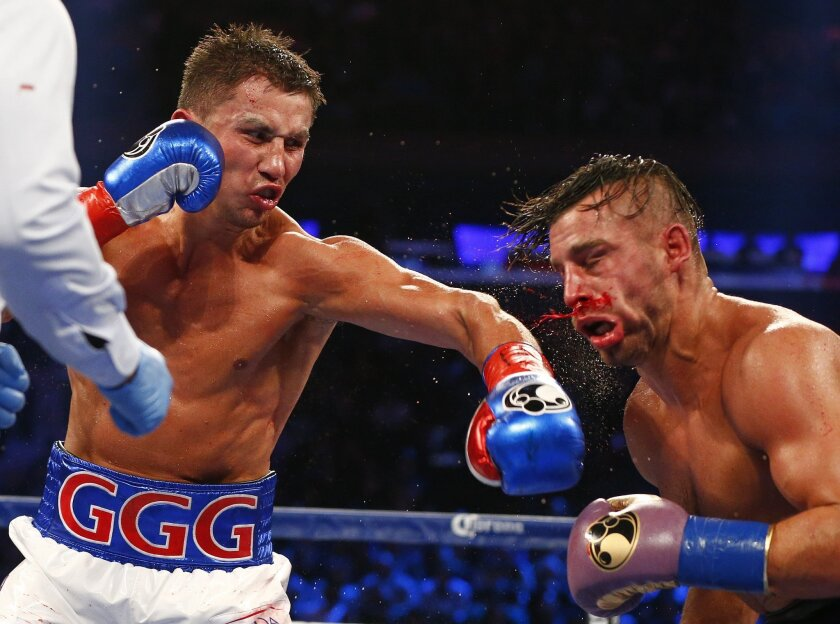 Gennady Golovkin, left, land a sleft against David Lemieux at Madison Square Garden on Oct. 17.