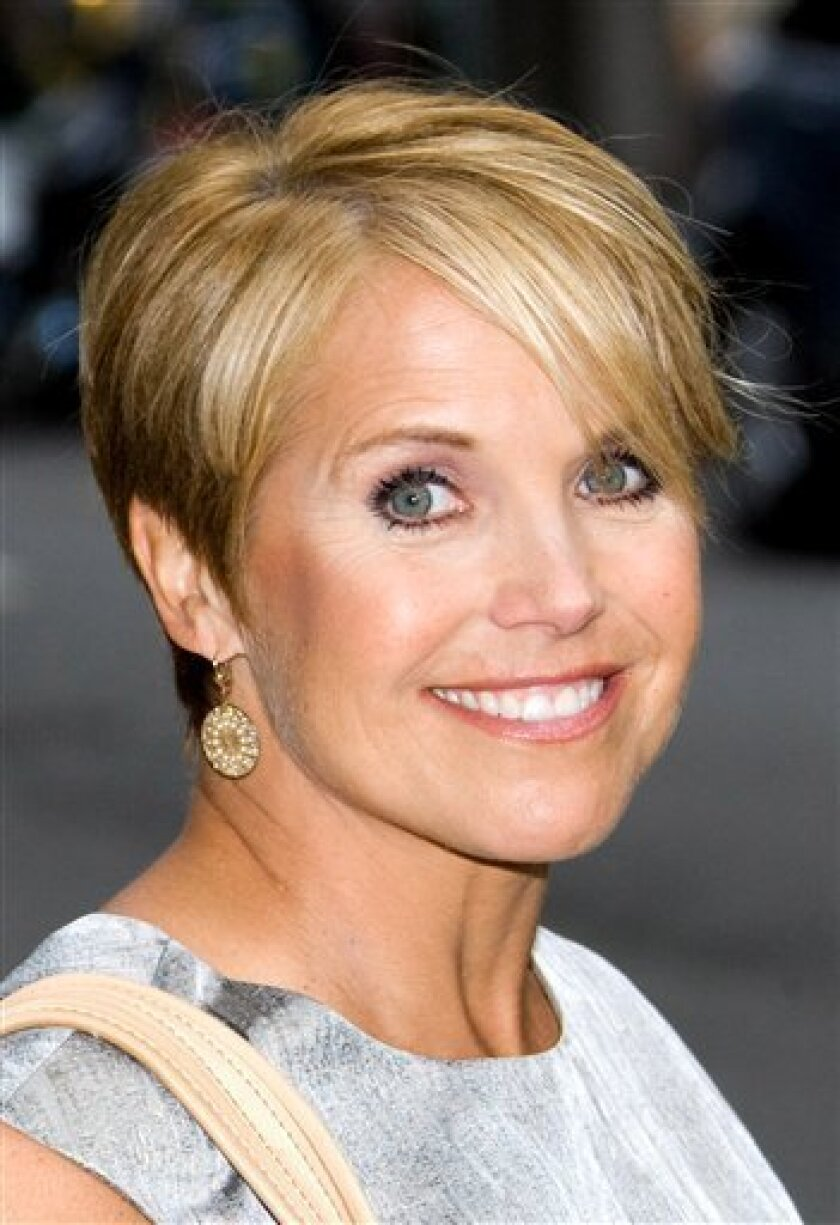 """FILE - In this July 28, 2009 file photo, CBS anchor Katie Couric leaves a taping of """"The Late Show with David Letterman"""" in New York. (AP Photo/Charles Sykes, file)"""