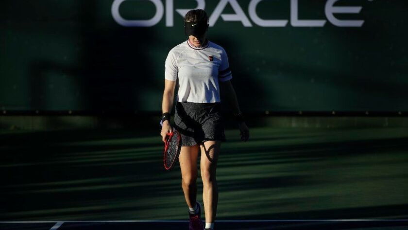Eugenie Bouchard walks off the court after her loss to Bianca Andreescu at the Oracle Challenger Series in Newport Beach on Friday.