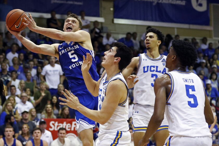 BYU guard Jake Toolson (5) shoots over the UCLA defense during the second half of an game Nov. 25 at the Maui Invitational in Lahaina, Hawaii.