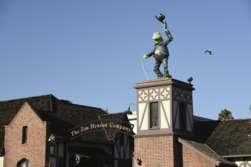 A statue of Kermit The Frog stands at the entrance to The Jim Henson Company, Tuesday, July 7, 2020, in the Hollywood section of Los Angeles. The U.S. government's small business lending program sent pandemic relief money into unexpected corners of the entertainment industry. The Muppet makers say they received about $2 million to keep their 75 workers employed through the coronavirus shutdown. (AP Photo/Chris Pizzello)