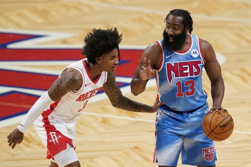 Brooklyn Nets' James Harden (13) calls out to a teammate as Houston Rockets' Kevin Porter Jr. (3) defends during the first half of an NBA basketball game Wednesday, March 31, 2021, in New York. (AP Photo/Frank Franklin II)
