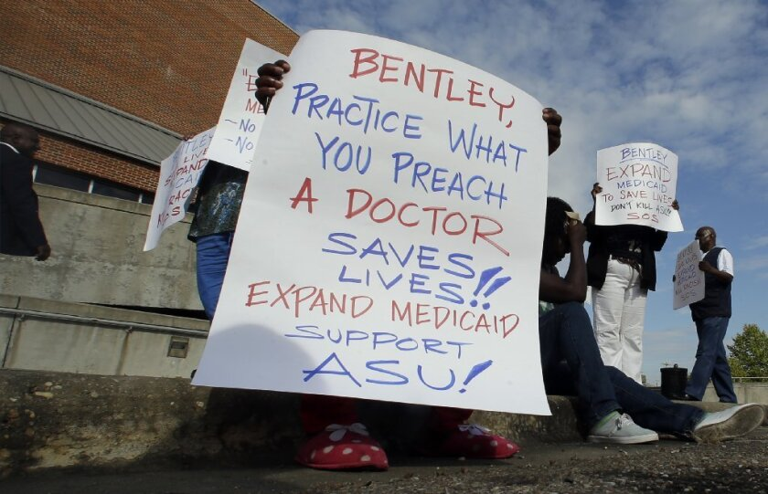 Alabama protester tries to get Gov. Robert Bentley to listen to reason.