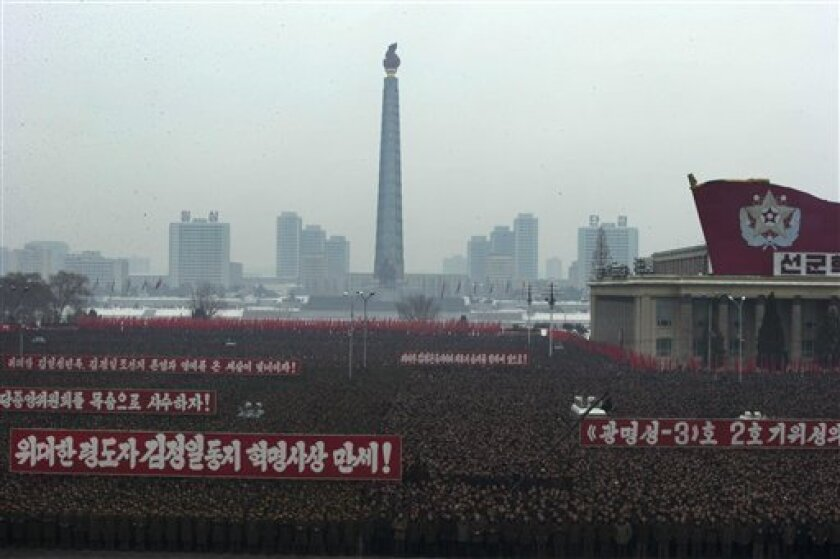 Slogans honoring the leadership and celebrating the successful rocket launch of a satellite are displayed during a mass rally on Kim Il Sung Square in Pyongyang, North Korea, Friday, Dec. 14, 2012. As the U.S. led international condemnation of what it calls a covert test of missile technology, top