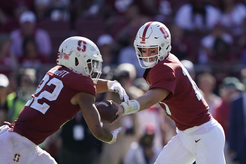 Stanford quarterback Davis Mills (15) hands off to running back Cameron Scarlett (22) against Northwestern during the second half on Saturday in Palo Alto.