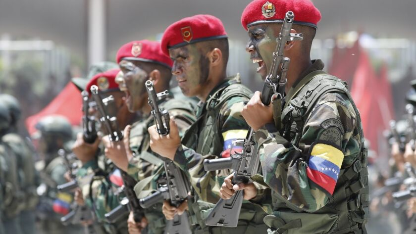 Soldiers march during a military parade marking Independence Day in Caracas, Venezuela, Friday July