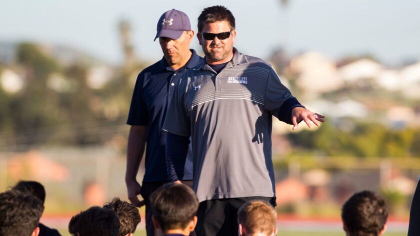 Del Norte head coach David O'Rielly (shown in an earlier game) speaks with his team at halftime.