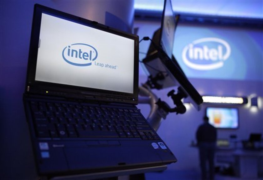 Intel logos are shown at the International Consumer Electronics Show(CES) in Las Vegas, Wednesday, Jan. 7, 2009. Bleak outlooks from Time Warner, Intel and Alcoa combined with more evidence of rising unemployment sent stocks sharply lower Wednesday, sending major indexes down more than 2 percent in