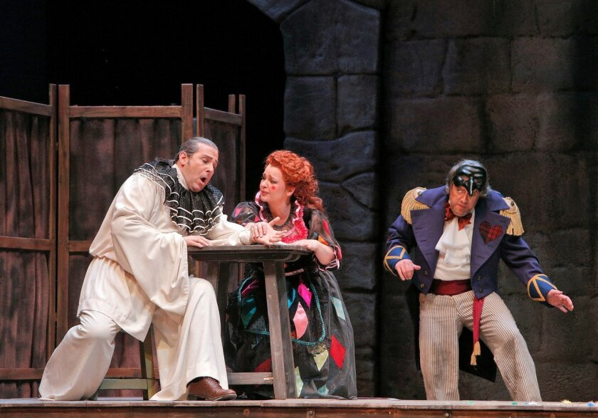 """Frank Porretta (from left), Adina Nitescu is Nedda and Stephen Powell in in the San Diego Opera's 2014 season-opening production of """"Pagliacci."""" Photo: Cory Weaver for the San Diego Opera"""
