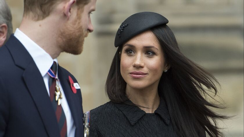 FILE - In this April 25, 2018 file photo, Britain's Prince Harry and Meghan Markle attend a Service
