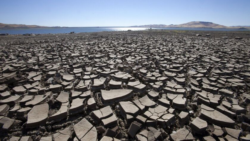 The San Luis Reservoir near Los Banos, Calif., was at then-record low levels in 2013.