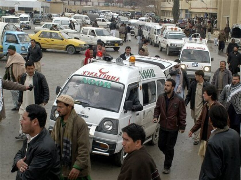 Ambulances are parked at a local hospital as they brought police officers on Wednesday, Jan. 14, 2009 in Quetta, Pakistan. Gunmen riding on a motorcycle fired on a vehicle carrying police officers near the southwestern Pakistani city of Quetta on Wednesday, killing four, police said. (AP Photo/Arsh