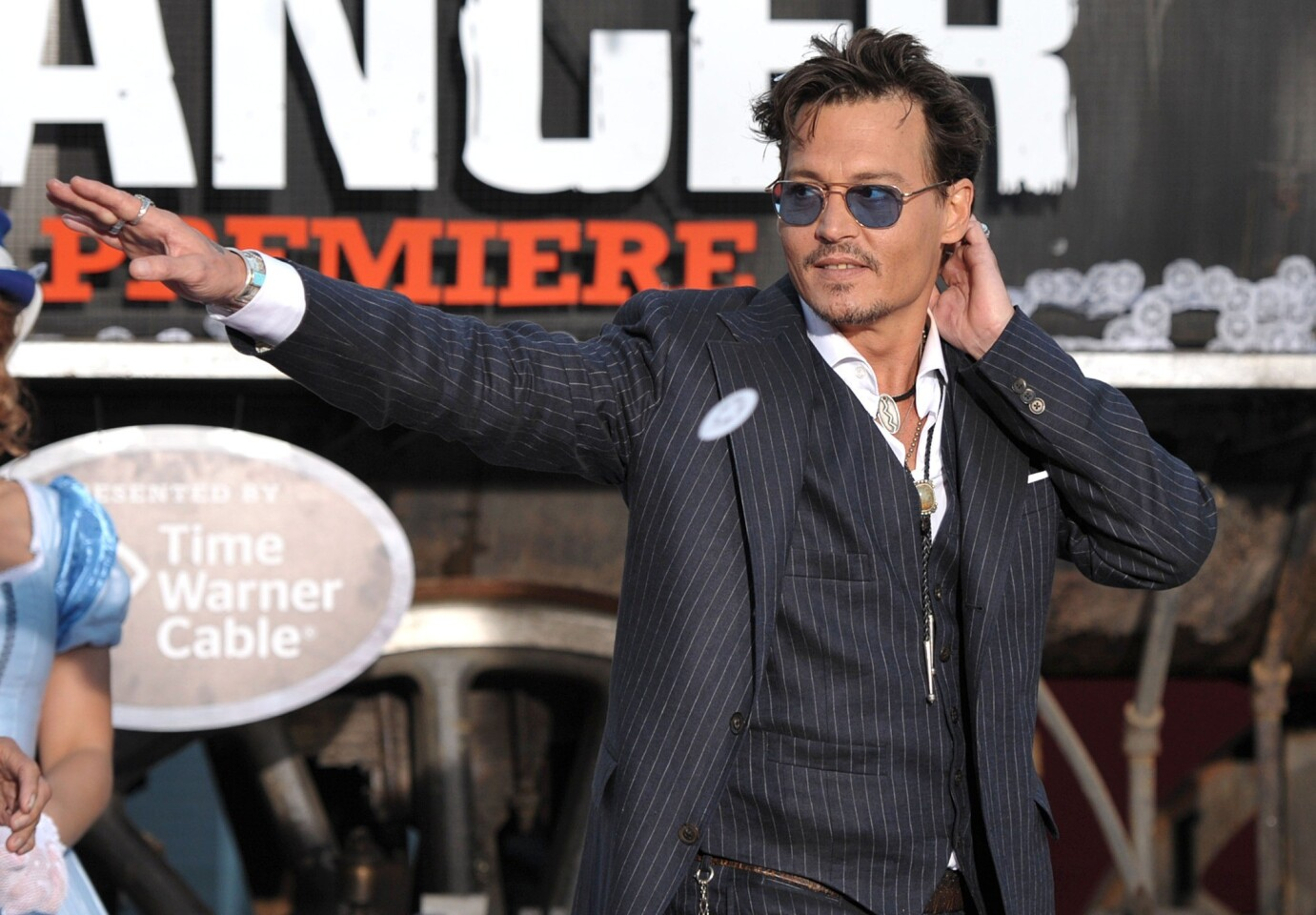 """Johnny Depp appears on stage at the world premiere of """"The Lone Ranger."""""""