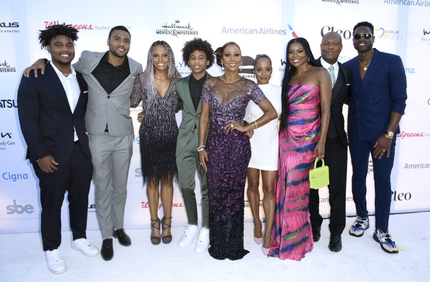 Holly Robinson Peete, center, with Essence Atkins, Gabrielle Union, husband Rodney Peete and Dwyane Wade at the HollyRod Foundation's 21st DesignCare Gala in Malibu on Saturday.