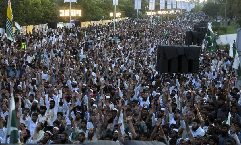 Supporters of Pakistan's religious group Jamaat-ud-Dawa raise their hands during an anti-Indian rally to express solidarity with Indian Kashmiris, in Islamabad, Pakistan, Wednesday, July 20, 2016. Pakistan Prime Minister Nawaz Sharif vowed that his country would continue extending political moral a